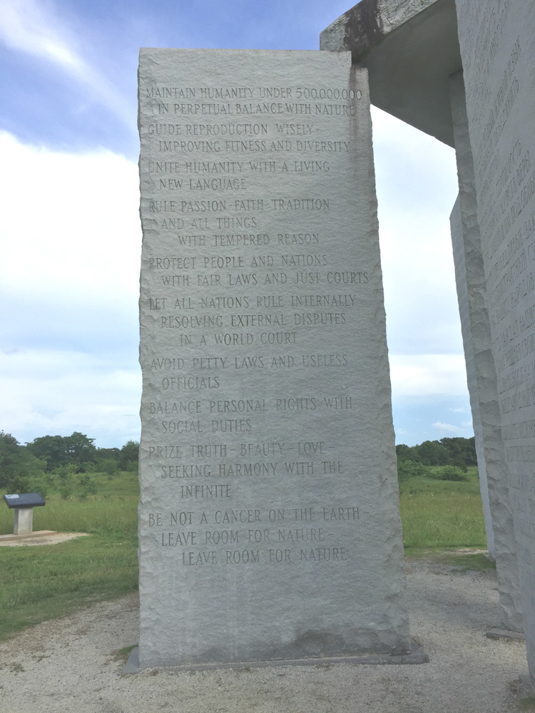 Granite monolith with decrees engraved in English text.